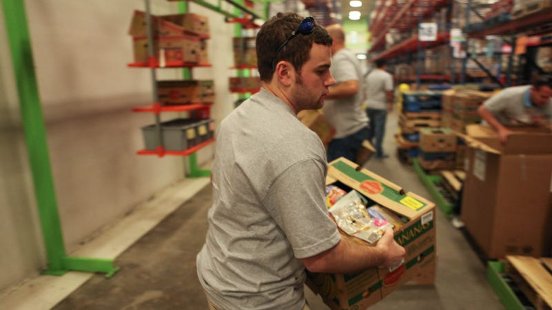 Instead, try this: schlepping boxes behind the scenes at a food bank in February. Photo by State Farm.