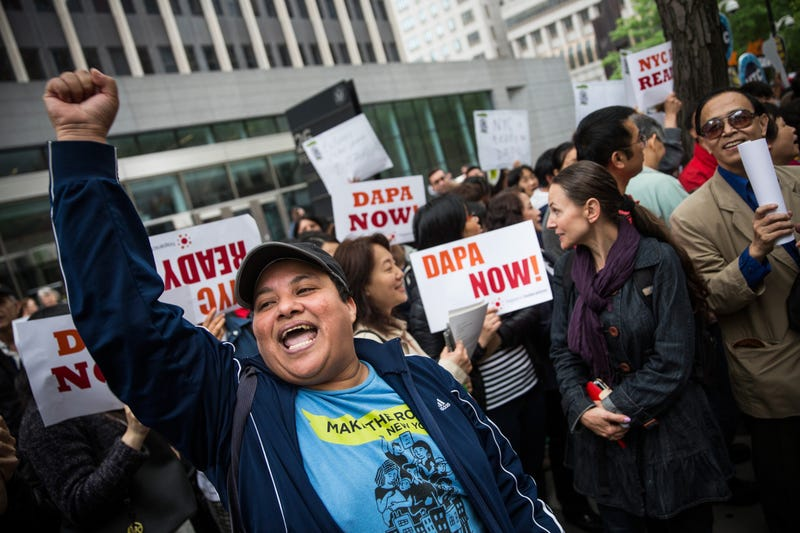 Activists calling for federal judges to reject challenges to President Barack Obama's Deferred Action for Parents of Americans and Lawful Permanent Residents program protest outside the Jacob K. Javits Federal Building, where naturalization ceremonies take place, in New York City on May 19, 2015.Andrew Burton/Getty Images