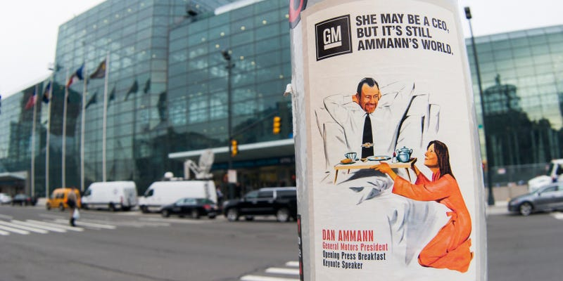 Illustration for article titled Some Troll Stuck A Ton Of Sexist Mary Barra Posters Around NY Auto Show