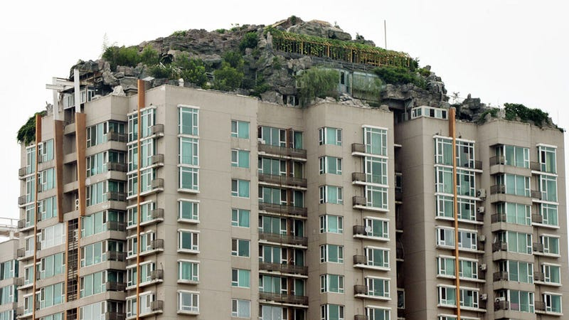 Illustration for article titled Chinese doctor builds illegal rock villa atop Beijing apartment tower