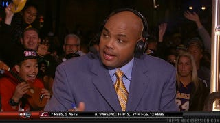 Illustration for article titled This Fan Behind Charles Barkley Is Awfully Excited To Be Holding A Ukulele