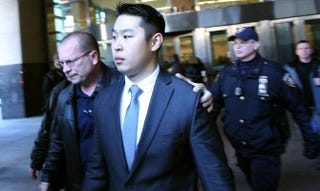 Peter Liang is escorted out of court on Feb. 11, 2015, in the Brooklyn borough of New York City. The former New York City officer was sentenced to probation and community service in the 2014 death of Akai Gurley.Spencer Platt/Getty Images
