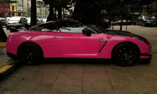 Illustration for article titled What car is so awesome you'd even drive it in hot pink?