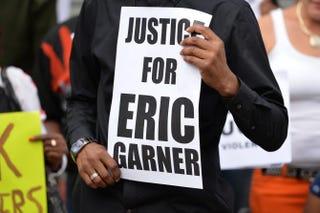 Demonstrators rally against police brutality in memory of Eric Garner on Aug. 23, 2014, in Staten Island, N.Y.STAN HONDA/AFP/Getty Images