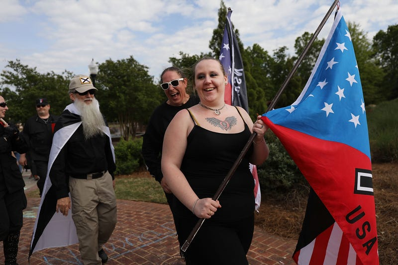Members and supporters of the National Socialist Movement, one of the largest neo-Nazi groups in the US, hold a rally in downtown Newnan on April 21, 2018 in Newnan, Ga. Community members have opposed the rally and have come out to embrace racial unity in the small Georgia town.