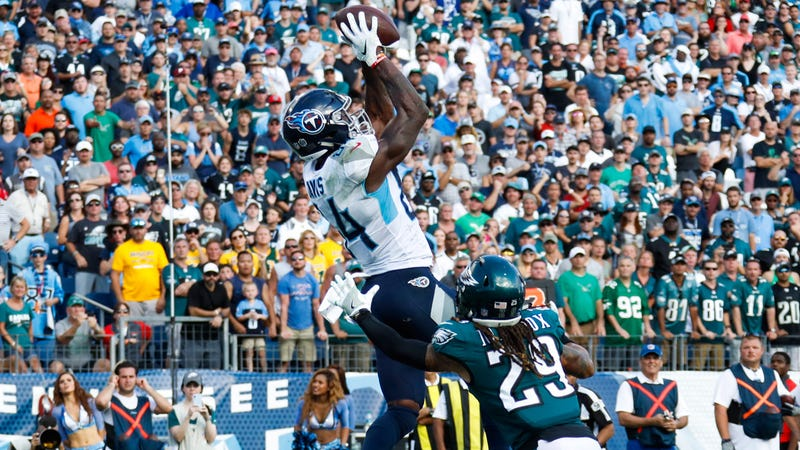Corey Davis catches the game-winning touchdown in overtime in the Titans win over the Eagles on Sunday.
