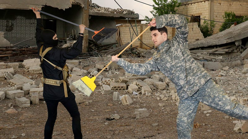 Illustration for article titled The Struggle Continues: America's Worst Soldier And ISIS's Worst Soldier Are Currently Hitting Each Other With Brooms