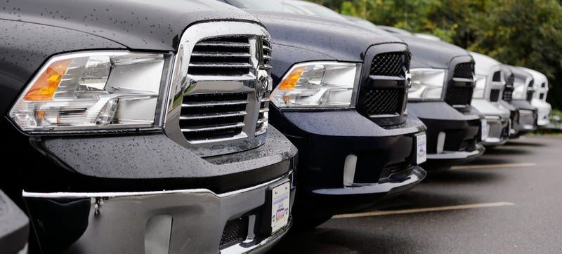 A line of Ram pickups at a different dealerships in 2014. The individual Rams in question are not pictured, but it's a line of Ram pickups just so you get the idea. Photo Credit: AP