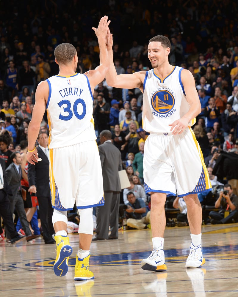 Stephen Curry and Klay Thompson of the Golden State Warriors celebrate during a game Jan. 2, 2015, in Oakland, Calif. Noah Graham/NBAE via Getty Images