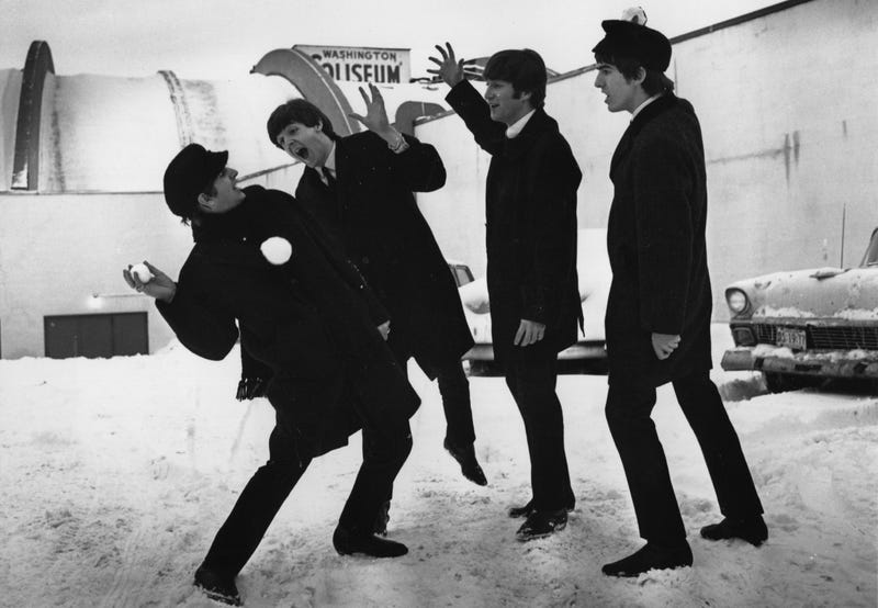 February 13th, 1964: The Beatles playing in the snow outside the Coliseum in Washington, D.C. (Photo: Central Press/Getty Images)