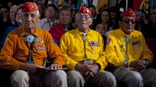 Bill Toledo, Peter MacDonald and George James Sr.—members of the Navajo Code Talkers—listen as President Barack Obama speaks to the 2012 Tribal Nations Conference at the Department of Interior in Washington, D.C., Dec. 5, 2012.Saul Loeb/Getty Images