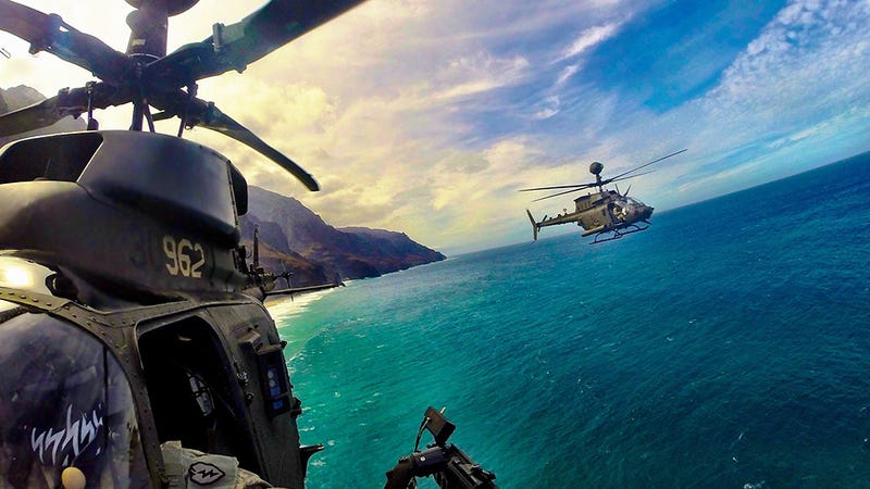Illustration for article titled Check Out This Award Winning Pic Of OH-58Ds Skirting The Hawaiian Coast