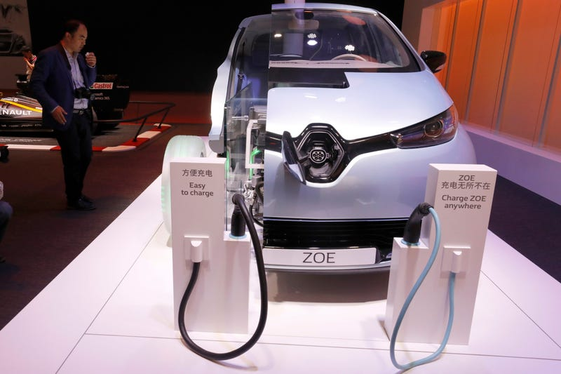 A visitor looks at a concept electric car system called the ZOE at the Renault stand during the Auto Shanghai 2017 show at the National Exhibition and Convention Center in Shanghai, China, Thursday, April 20, 2017. Photo credit: AP Images