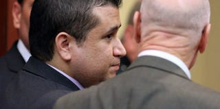 George Zimmerman confers with his lawyer in court after his acquittal. (Pool/Getty Images)