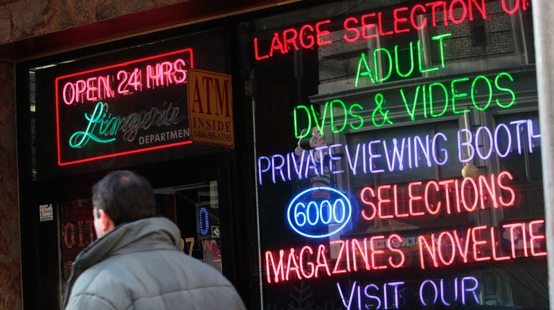 A man passes by an adult video store January 8, 2009 in New York.