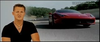 Illustration for article titled VIDEO: Michael Schumacher Wears Skin-Tight Black T-Shirt, Talks Ferrari 458 Italia