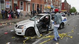A Baltimore police car destroyed by demonstrators sits in the street near the corner of Pennsylvania and North avenues during violent protests following the funeral of Freddie Gray in Baltimore April 27, 2015.Chip Somodevilla/Getty Images