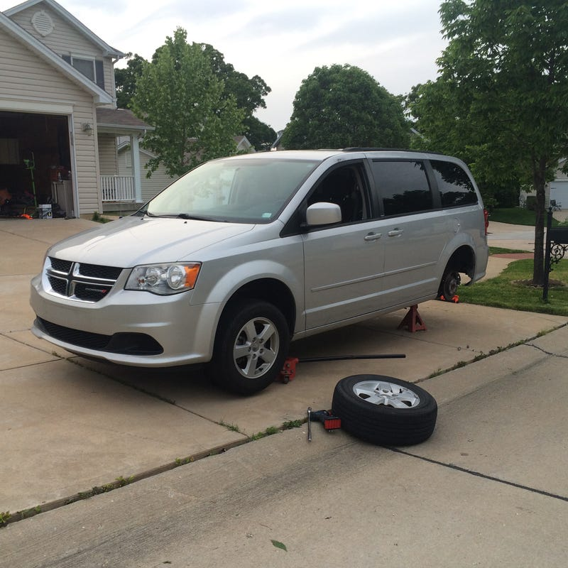Illustration for article titled So this is the van we bought. Leaving for vacation road trip tomorrow when kids wake up.