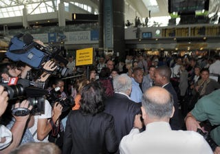 Mob scene at JFK Airport as Strauss-Kahn heads for home.