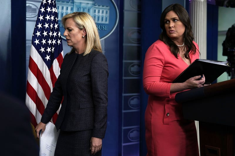 Secretary of Homeland Security Kirstjen Nielsen leaves after she briefed members of the press as White House press secretary Sarah Sanders looks on during a White House daily news briefing at the James Brady Press Briefing Room of the White House on June 18, 2018, in Washington, D.C.