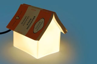 Illustration for article titled Turn Your Book into This Lamp's Roof (And Save Your Spot)