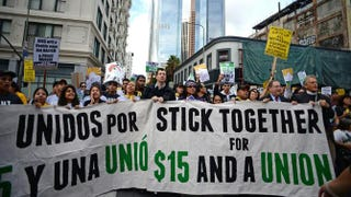 Fast-food workers, health care workers and their supporters shout slogans during a rally and march in Los Angeles Dec. 4, 2014, to demand an increase of the minimum wage to $15 per hour.Robyn Beck/Getty Images