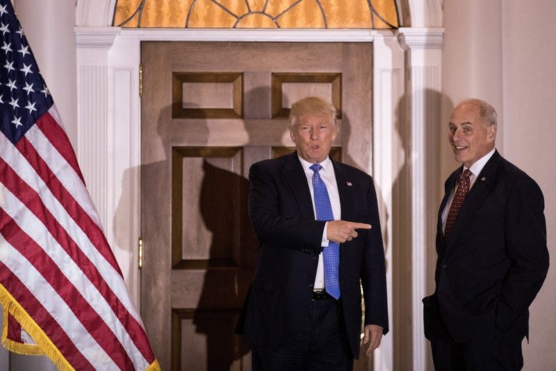 Donald Trump points at U.S. Marine Corps General John Kelly before their meeting at Trump International Golf Club, November 20, 2016 in Bedminster Township, New Jersey.