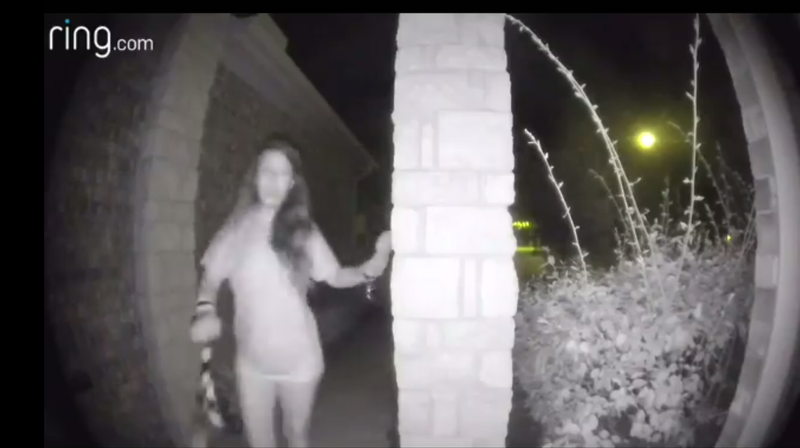 A woman seen ringing a doorbell in Montgomery County, Texas on August 26th, 2018.