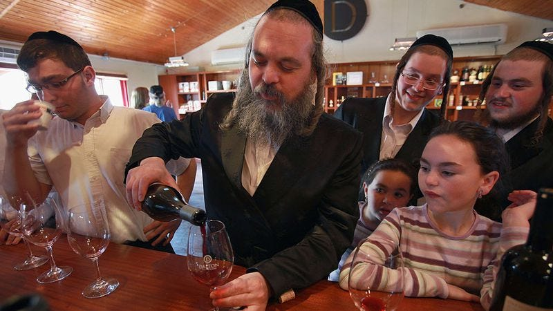 An ultra-Orthodox Jew tastes wine at Dalton Winery in Israel's northern Galilee region. (Photo: David Silverman/Getty Images)