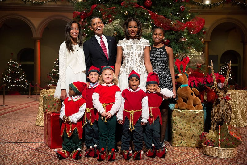 """President Barack Obama, first lady Michelle Obama, and daughters Malia and Sasha join """"elves"""" on Dec. 15, 2013.Official White House Photo by Pete Souza"""