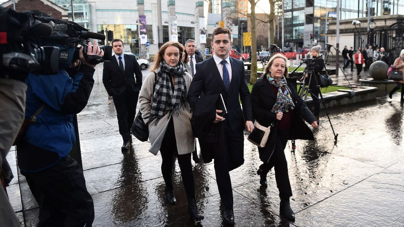 Paddy Jackson arrives at Belfast Laganside courts with family members on January 29, 2018 in Belfast, Northern Ireland. The Ireland and Ulster rugby player is accused of raping a woman in June 2016 at a property in south Belfast along with fellow Ulster and Ireland international Stuart Olding.