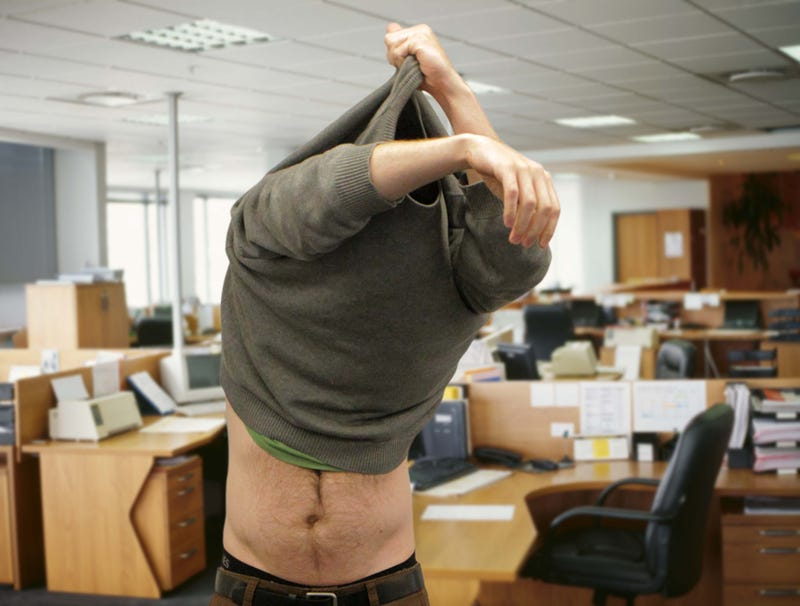 Illustration for article titled Man Removing Sweatshirt Offers Coworkers Tantalizing Glimpse Of Bare Midriff