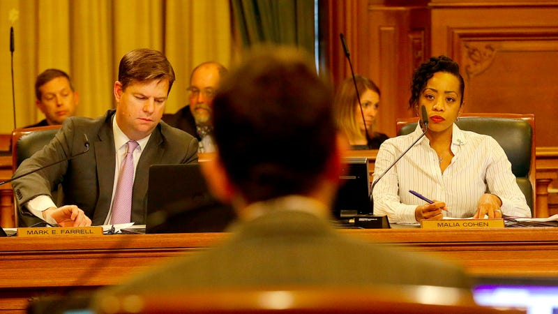 Mark Farrell, left, and Malia Cohen, right, listen as Scott Wiener, foreground, speaks during a San Francisco Board of Supervisors meeting at City Hall in San Francisco, Tuesday, April 5, 2016. Photo via AP Images.