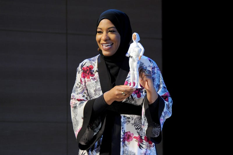 U.S. Olympic medalist Ibtihaj Muhammad speaks onstage holding the new Barbie doll made in her image during an event at the Brooklyn Museum in New York City on Nov. 13, 2017. (Craig Barritt/Getty Images for Glamour)