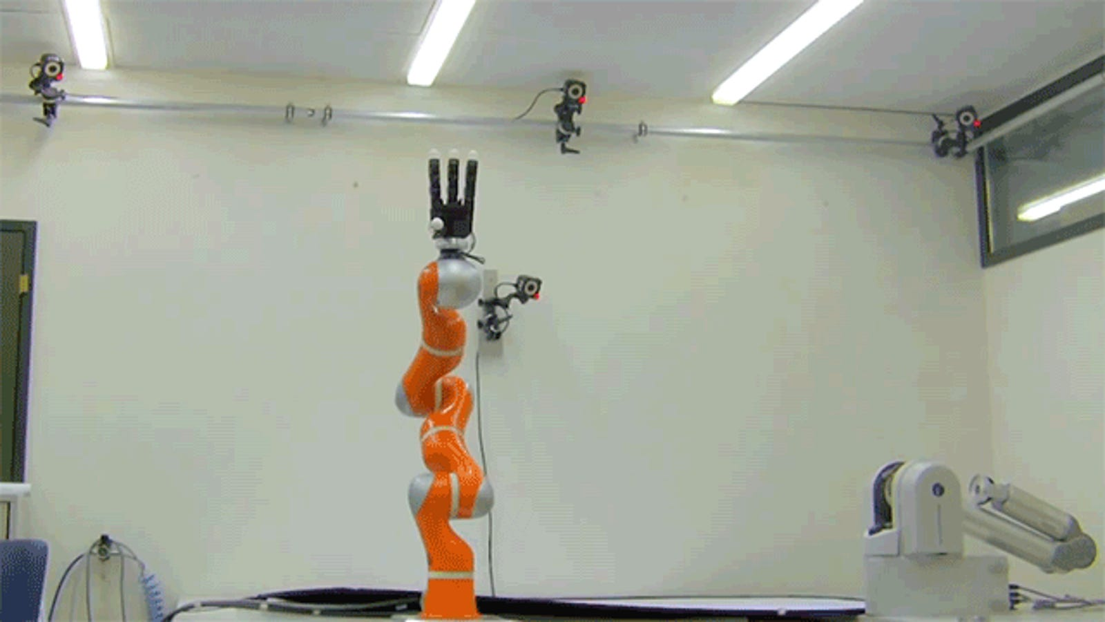 A High-Speed Robot Arm That Snatches Objects Out of Mid-Air