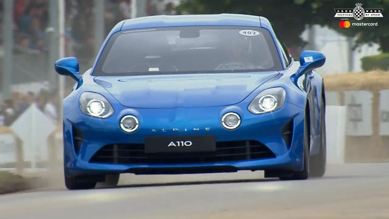 The Alpine A110 squatting under heavy braking up the hill at Goodwood.