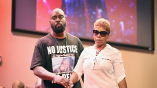 Michael Brown Sr. and Lesley McSpadden, the parents of slain teenager Michael Brown, attend a rally at Greater Grace Church in Ferguson, Mo., on Aug. 17, 2014. Scott Olson/Getty Images