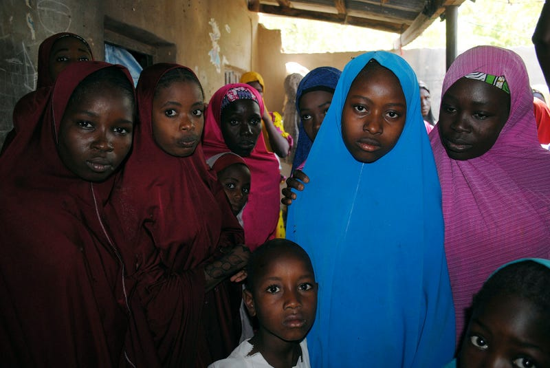 Aishat Alhaji (second from right), one of the kidnapped girls from the Government Girls Science and Technical College Dapchi who was freed, after her release, in Dapchi, Nigeria, on March. 21, 2018.