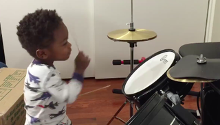 One-year-old L.J. on the drumsFacebook