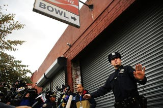 On Oct. 24, 2014, police keep members of the media and others back from the closed Brooklyn bowling alley that Dr. Craig Spencer, New York City's first Ebola patient, visited before showing symptoms of the virus.Spencer Platt/Getty Images