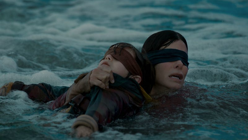 Julian Edwards and Sandra Bullock brave the rapids in Netflix's Bird Box.
