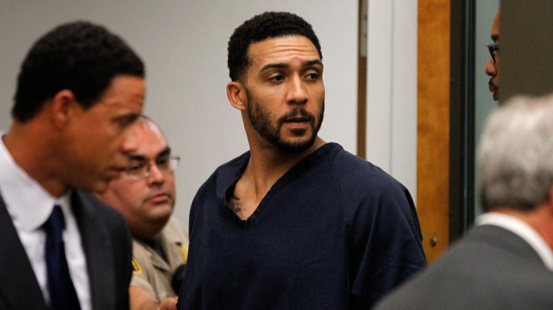 Kellen Winslow Jr., center, leaves his arraignment Friday.