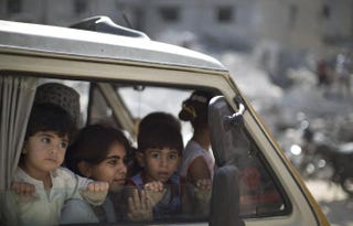 Palestinians who were displaced from their houses because of fighting between Israel's army and Hamas fighters return to check their homes in Gaza City's Shejaiya neighborhood in the Gaza Strip Aug. 1, 2014.MAHMUD HAMS/AFP/Getty Images