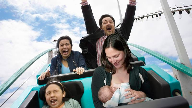 A woman breastfeeding on a roller coaster.