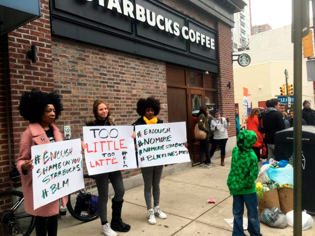 Protesters on April 15, 2018, gather outside a Starbucks in Philadelphia, where two black men who were waiting for a friend were arrested after Starbucks employees called police to say the men were trespassing.