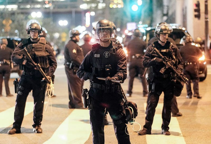 Police in riot gear stand guard outside City Hall during a protest against  President-elect Donald Trump in Los Angeles, Nov. 13, 2016. RINGO CHIU/AFP/Getty Images)