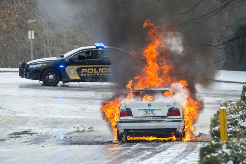 A Burning Bmw Photo Credit Ap