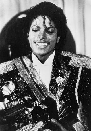 Michael Jackson holding the several Grammy awards he won at the 1984 Grammy ceremonies Feb. 28, 1984, in Los Angeles. His top award was Album of the Year for Thriller.SUSAN RAGAN/AFP/Getty Images