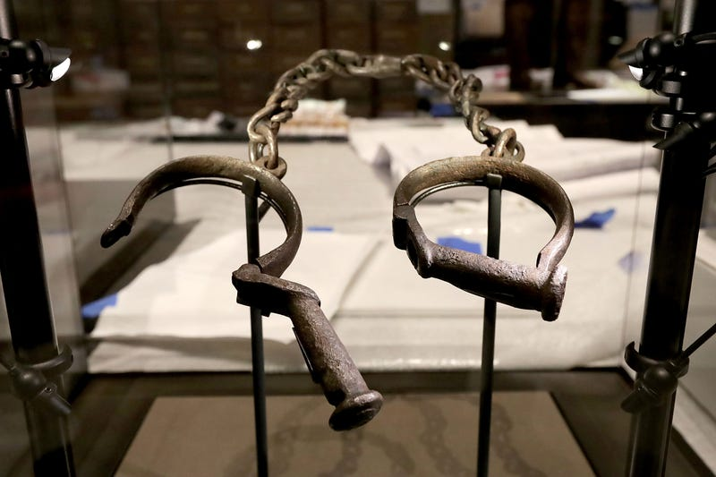A pair of slave shackles in the Slavery and Freedom Gallery in the Smithsonian's National Museum of African American History and Culture  on the National Mall in Washington, D.C., during the press preview Sept. 14, 2016 (Chip Somodevilla/Getty Images)