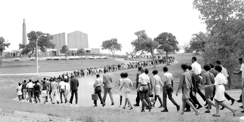 Faculty, staff and students walk toward Bishop College Chapel in Dallas for an all-night prayer vigil on April 4, 1968, after the murder of the Rev. Martin Luther King Jr. in Memphis. In other cities, violence erupted. (Dallas Public Library)